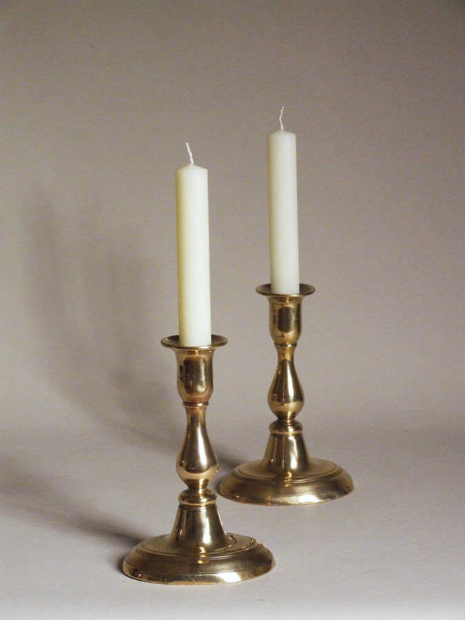 Pair of brass candlesticks by Harrison