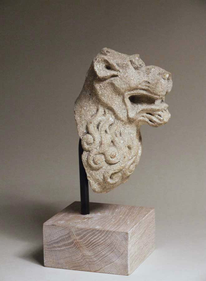 Carved stone lion's head