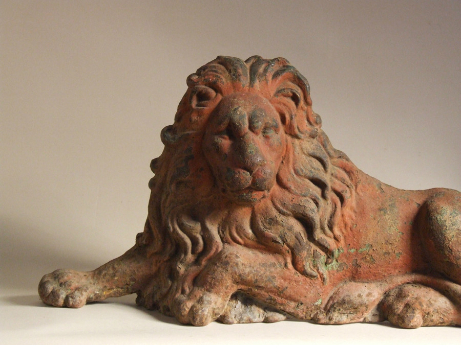 Wonderful recumbent lion with early paint