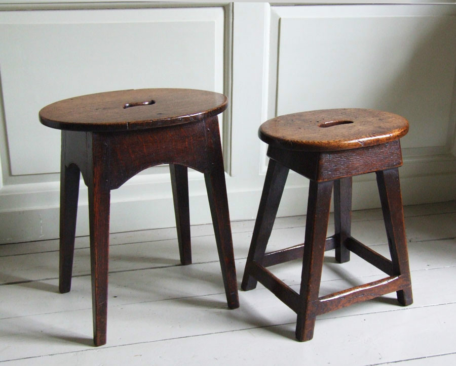 Two oval-topped oak stools